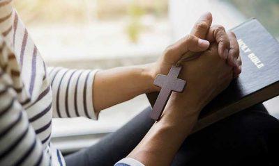 Christian Woman Praying and Reading Holy Bible
