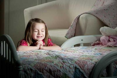 little girl praying at night